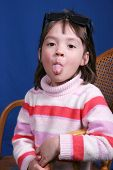 Little Girl Sticks Out Tongue. poster
