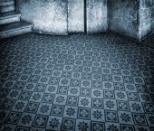 Blue historic interior with empty tile floor and marble wall