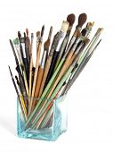 Artist's brushes in the glass isolated on white
