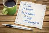 Think positive and positive things will happen - law of attraction concept - handwriting on a napkin poster