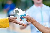 Grabbing Water During A Marathon