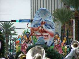 picture of mardi-gras  - Over the Moon float in the Rex Mardi Gras parade passes over Carondelet Street on Canal Street in New Orleans  - JPG