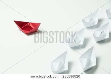 Red Paper Ship Changing Direction