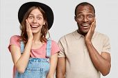 Lovely Glad Satisfied Caucasian Female And His African American Male Touch Cheeks, Express Positive poster