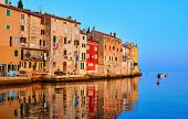 Rovinj, Istria, Croatia. Antique medieval houses at coastline of Adriatic sea. Sunrise with blue sky poster