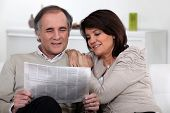 Couple reading the newspaper together