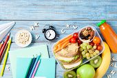Back To School Concept. Healthy Lunch Box And Colorful Stationery On Turquoise Wooden Table Top View poster