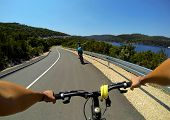 Woman Riding A Bike On Mljet Island, Croatia. Near Sea And Mountains In Summer. Female Rider Cycling poster