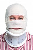 Photo of an injured man with a head bandage and Cervical neck collar, isolated on a white background