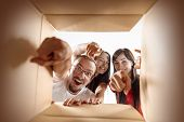 The Surprised Caucasian Man And Women Opening Carton Box And Looking Inside. The Package, Delivery,  poster