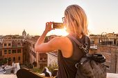 Female Tourist Taking Mobile Phone Photo Of Piazza Di Spagna, Landmark Square With Spanish Steps In  poster