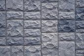 Textured Stone Walls Built Of Large Rough Stones Held Together By  Lumps Of  Cement . Stones Backgro poster
