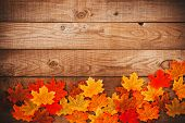 Autumn Maple Leaves Over Old Wooden Background With Copy Space. Border Frame Design. poster