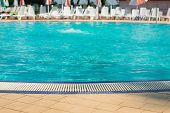 Water Swimming Pool. Pool With Blue Water. Background Of Clean Blue Rippled Water In A Hotel Swimmin poster