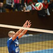 KAPOSVAR, HUNGARY - NOVEMBER 13: Balint Magyar in action at a Hungarian National Championship volleyball game Kaposvar (blue) vs. Nyiregyhaza (red), November 13, 2011 in Kaposvar, Hungary.
