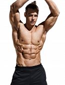 Sporty Man Showing Off His Muscular Physique And Six Pack Abs. Photo Of Young Man With Perfect Body  poster