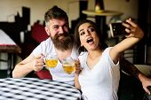 Couple Cheerful Mood Drinking Beer In Pub. Couple In Love On Date Drinks Beer. Take Selfie Photo To  poster