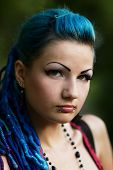 foto of piercings  - Scary but beautiful young punk girl with piercing on her face - JPG