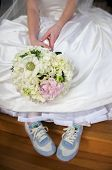 Bride In Gown With Tennis Shoes