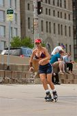 Athletic Woman Rollerblades In Chicago