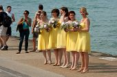 Bridesmaids Prepare For Photo Standing By Lake Michigan