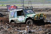 Offroad Race 4X4 Car In The Bog.