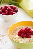Oatmeal porridge with fresh raspberry