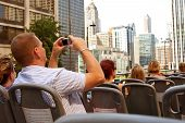 Tourist Snaps Photos Of Chicago Skyline From Sightseeing Bus