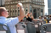 Tourists Snap Photos Of Chicago Skyline From Sightseeing Bus