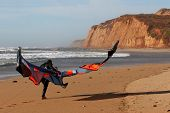 Kite Surfer Walking On The Beach
