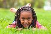 Outdoor Portrait Of A Cute Young Black Girl Smiling - African People