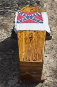 picture of rebel flag  - A wooden coffin with a confederat flag draped upon it - JPG