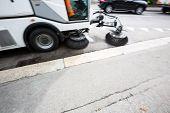foto of sweeper  - Detail of a street sweeper machine - JPG