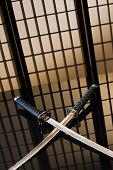 Katana And Wakizashi With Naked Blades On A Table