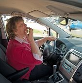 Middle-aged Woman In A Car