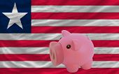 Piggy Rich Bank And  National Flag Of Liberia