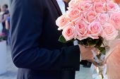 Man Holding Bouquet In Hands