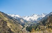Panorama Of Nature  Green Mountains, Snow And Blue Sky In Chimbulak Almaty,  Kazakhstan