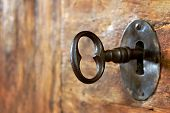 picture of wooden door  - Closeup of an old keyhole with key on a wooden antique door