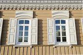 Two windows with wooden shutters. Irkutsk