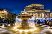 stock photo of fountains  - Fountain and Bolshoi Theater Illuminated in the Night Moscow Russia - JPG