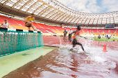 MOSCOW - JUN 11: Runners overcomes obstacles on International athletic competition Moscow Challenge