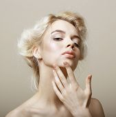 Sentimentality. Natural Blonde Woman Touching Her Clean Face. Pampering