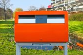Dutch Public Orange Mailbox On A City Street. Netherlands
