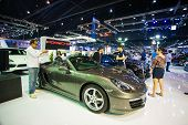 Unidentified people look at porsche 911 Carrera S