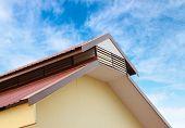 Gable Roof Against Blue Sky