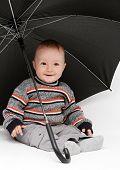 Baby Boy Sitting Under Umbrella