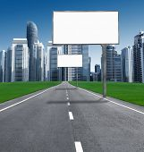 Road into town with established billboards. blank billboards for advertising along the streets of the city with skyscrapers.