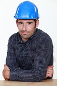 Portrait of an uneasy tradesman