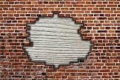 Brick Wall With Hole And Wooden Board